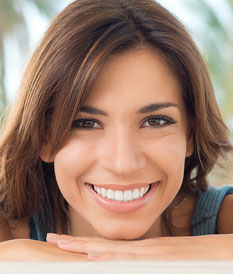 Woman smiling with hidden SureSmile QT lingual braces